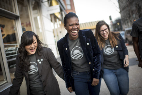 Staff and volunteers model Barack Obama Foundation merchandise at their offices on Thursday December 14, 2017 in Chicago, IL. Photo: Christopher Dilts / Barack Obama Foundation