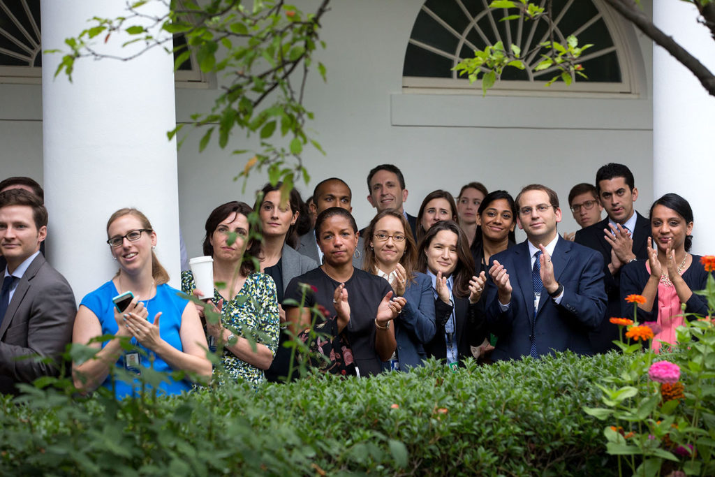 Staff listen to remarks by President Obama in the Rose Garden.