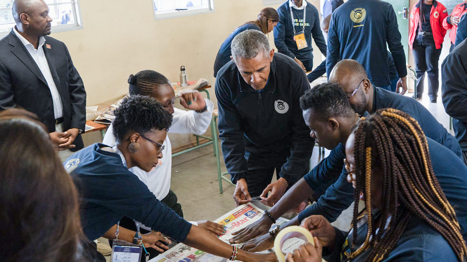 President Obama works with members of the first Leaders: Africa class at a service project in Johannesburg.