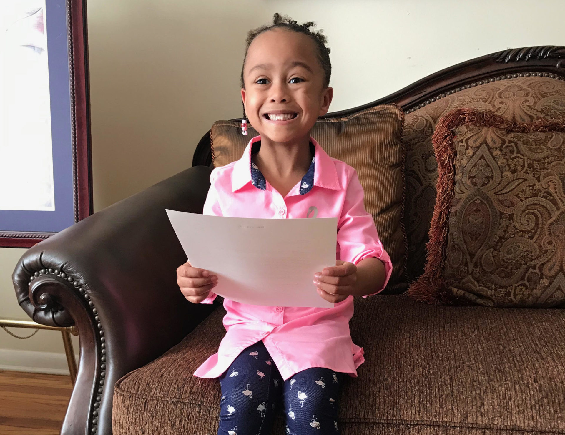 Five-year-old Cori Ryan grins as she holds her letter from President Obama.