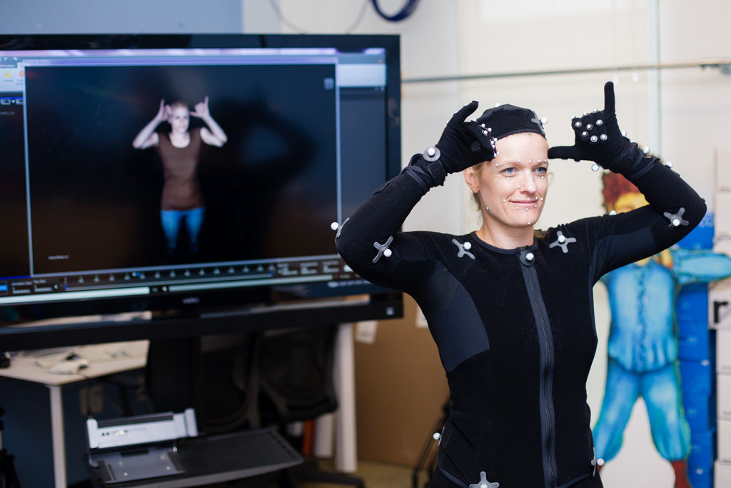 Melissa serving as a motion capture model to create a 3D avatar.