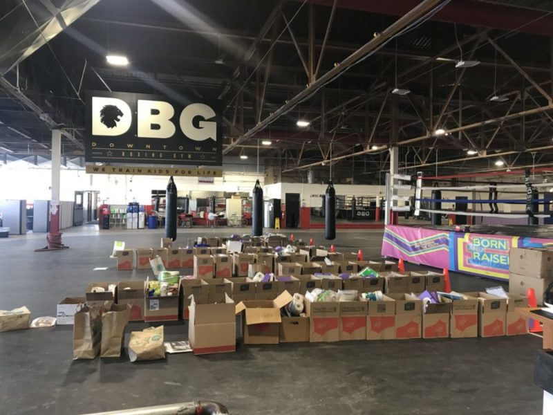 This is the Downtown Boxing Gym, normally packed with students, instead filled with boxes that contain meals, supplies and academic packets to be delivered to students and their families.