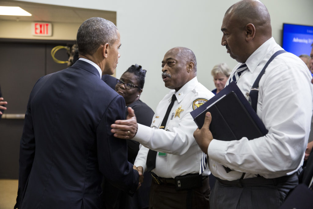 President Barack Obama greets Prince George's County (Md.) Sheriff Melvin High and other law enforcement and civic leaders in the audience after he delivers remarks during the 21st Century Policing event in the Eisenhower Executive Office Building South Court Auditorium, July 22, 2016.