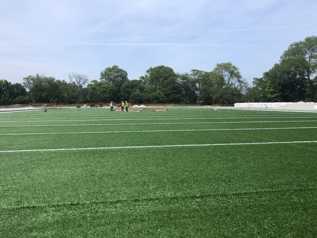 A football field is shown from the end zone area.