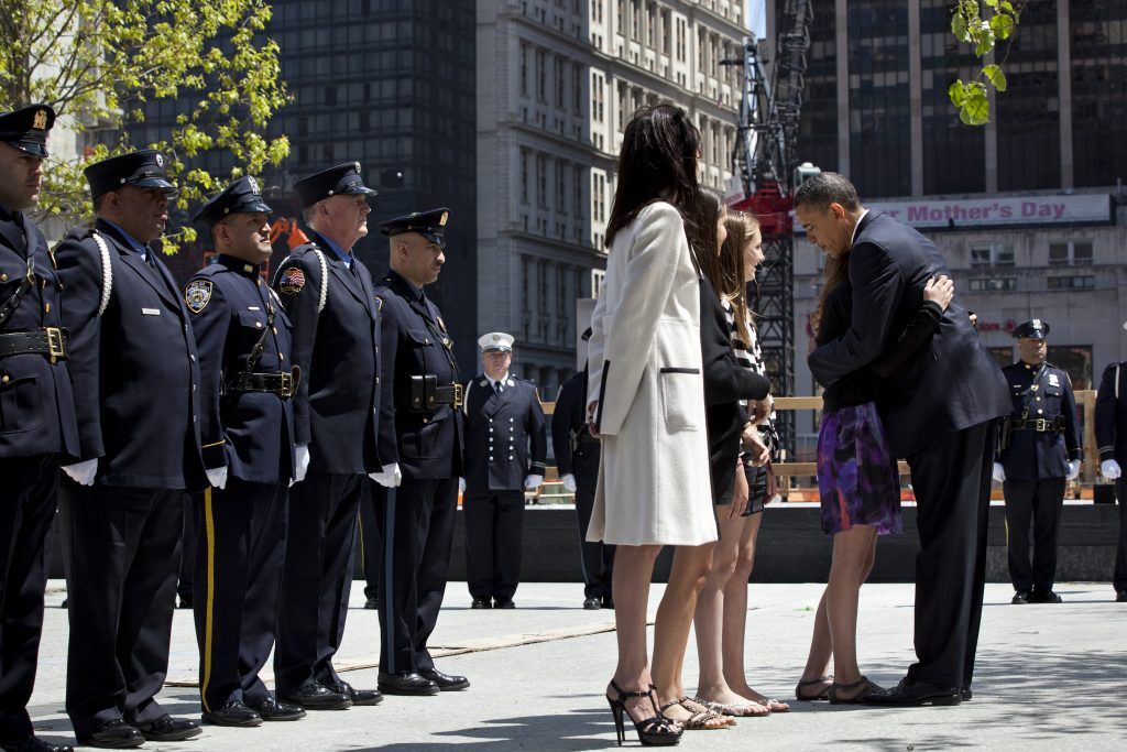President Obama hugs a young woman at New York City's Ground Zero.