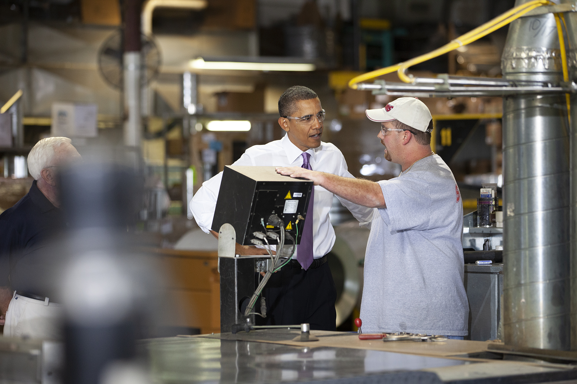 President Obama talks to a factory worker.