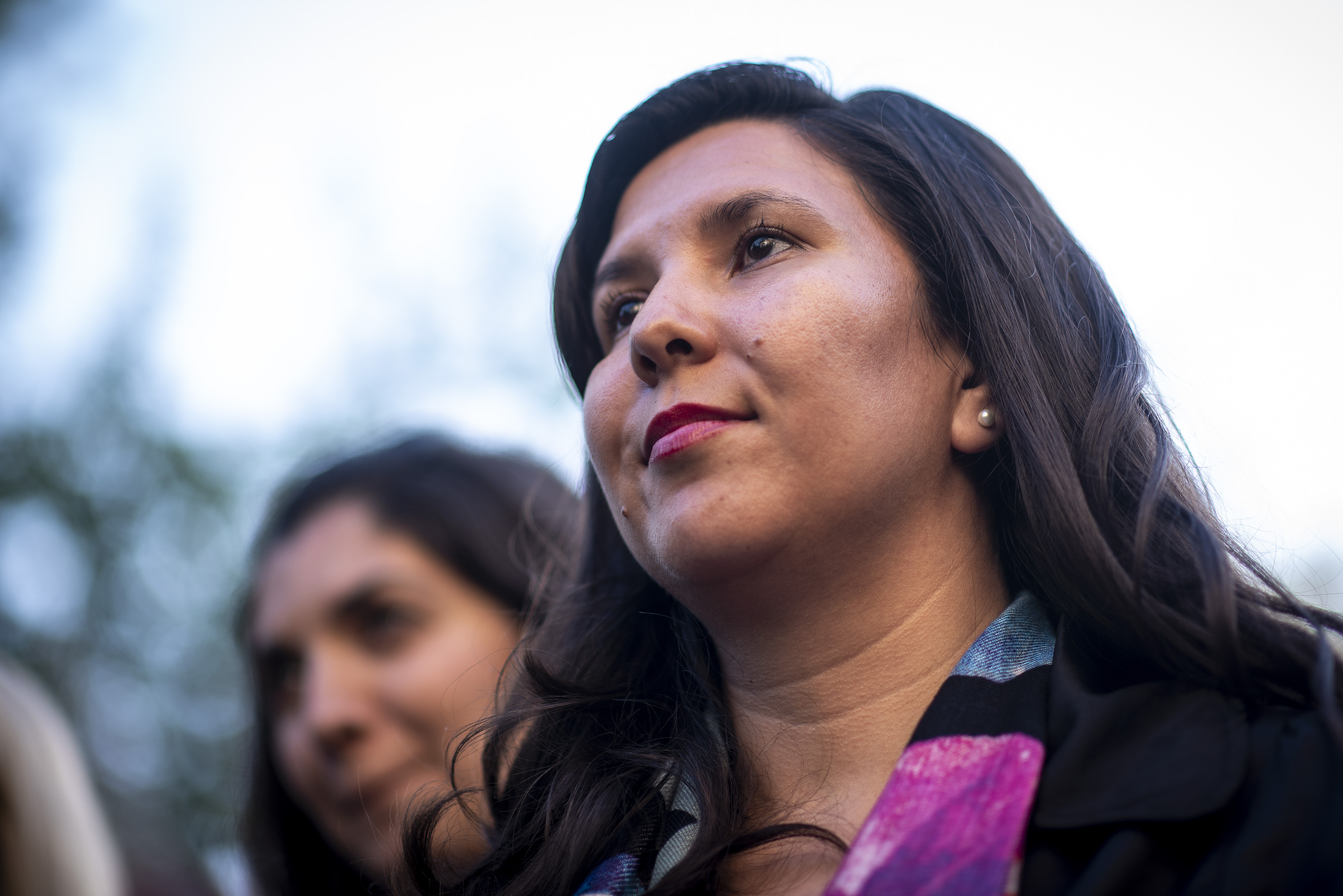 Obama Fellow Veronica Crespin-Palmer listens to a speech during an event.