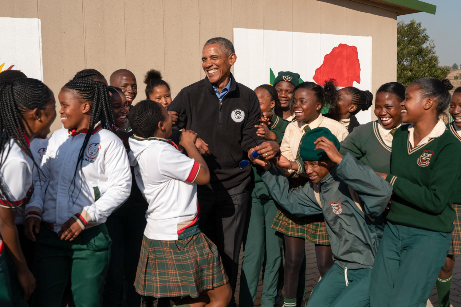 President Obama plays with school children during a service project in Johannesburg.
