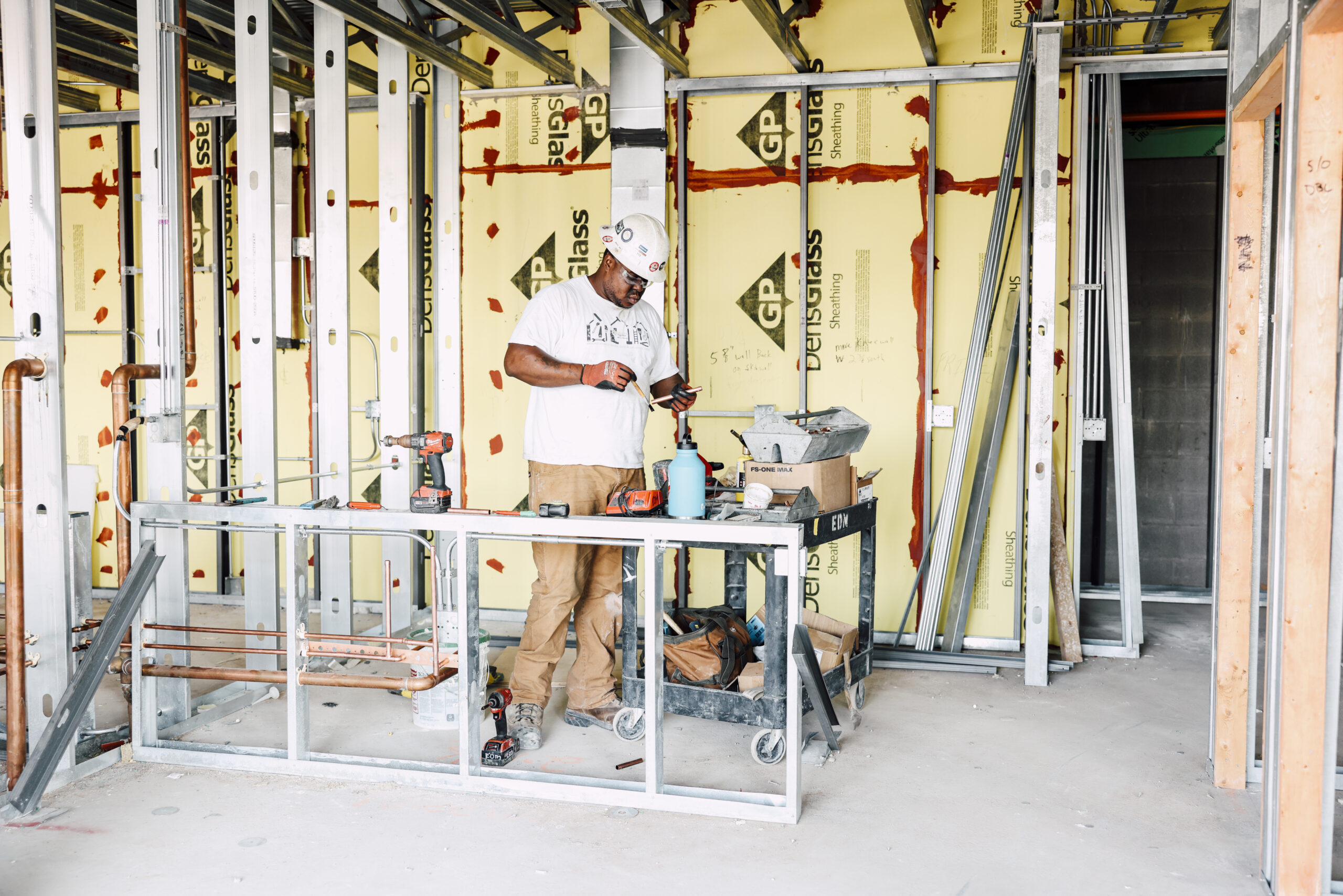 A man in a hard hat working at a construction site.