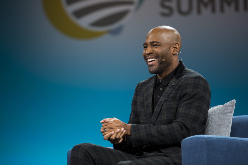 Karamo Brown smiles at the audience during his Summit conversation with Tara Westover.
