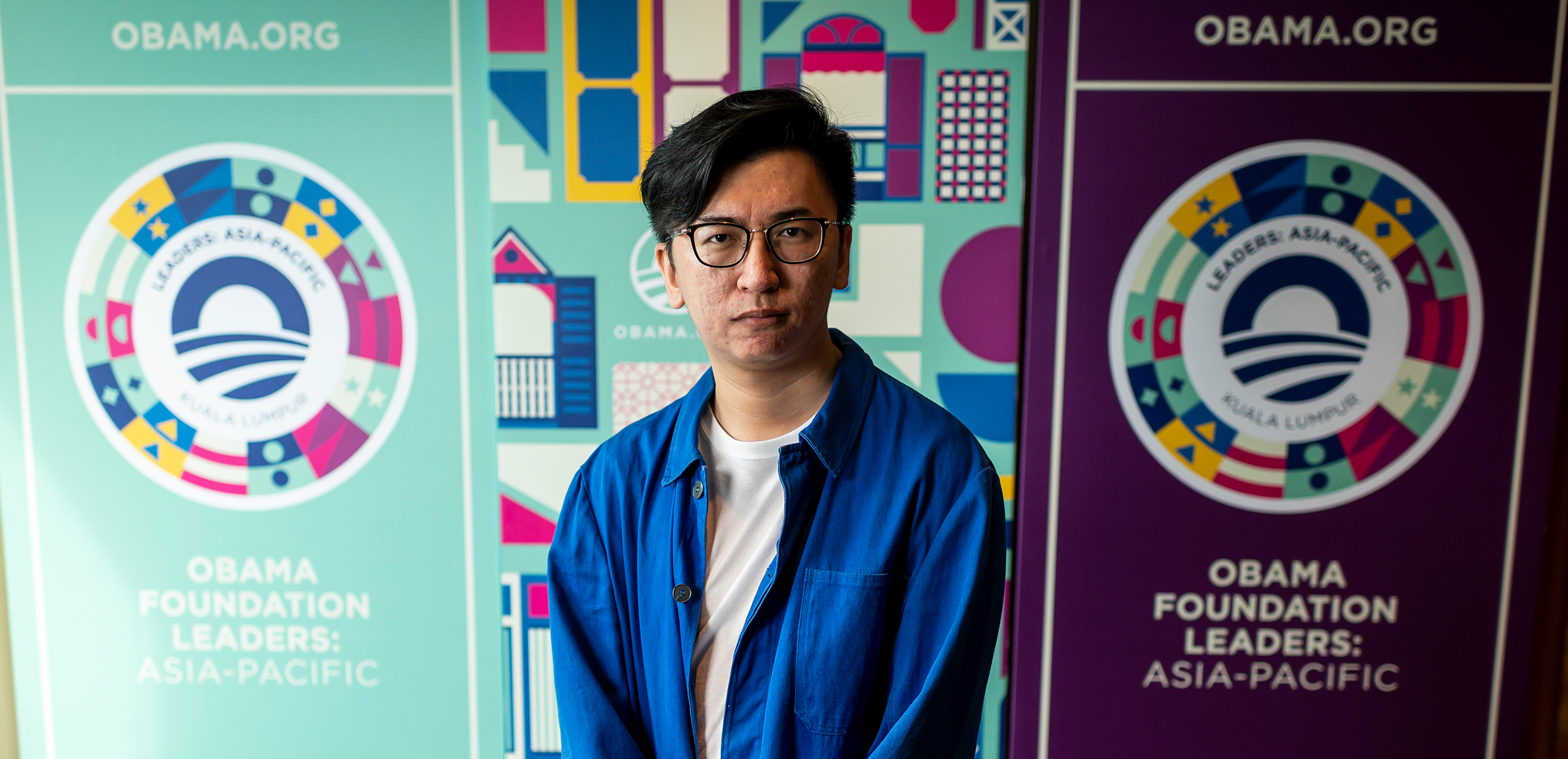The designer for Leaders: Asia-Pacific, Valen Lim Chong Chin stands in front of his work.