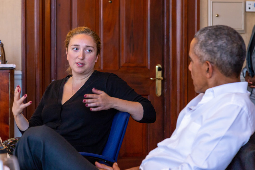 President Obama listens to Guoda Lomanaite during a roundtable conversation.