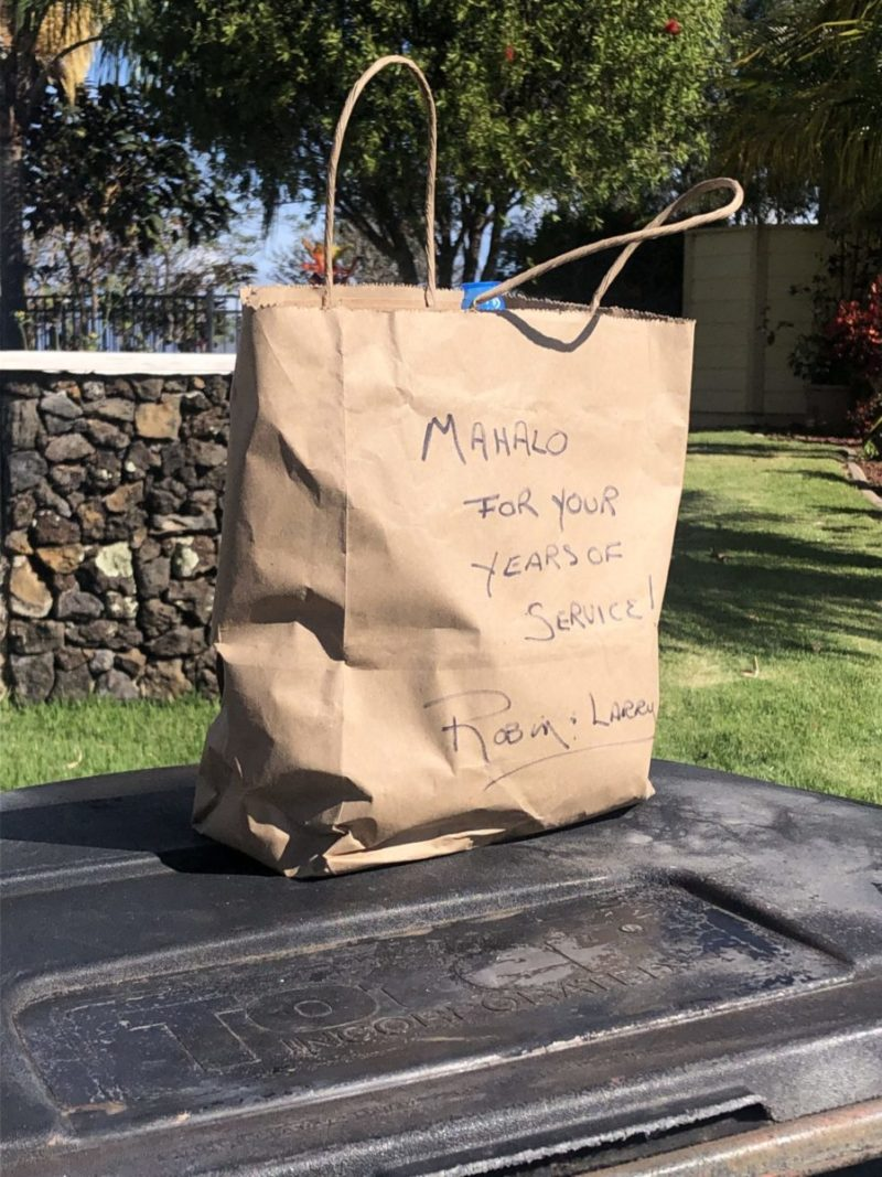 A paper bag with a thank you note on it awaits the workers who clear Robin's garbage.