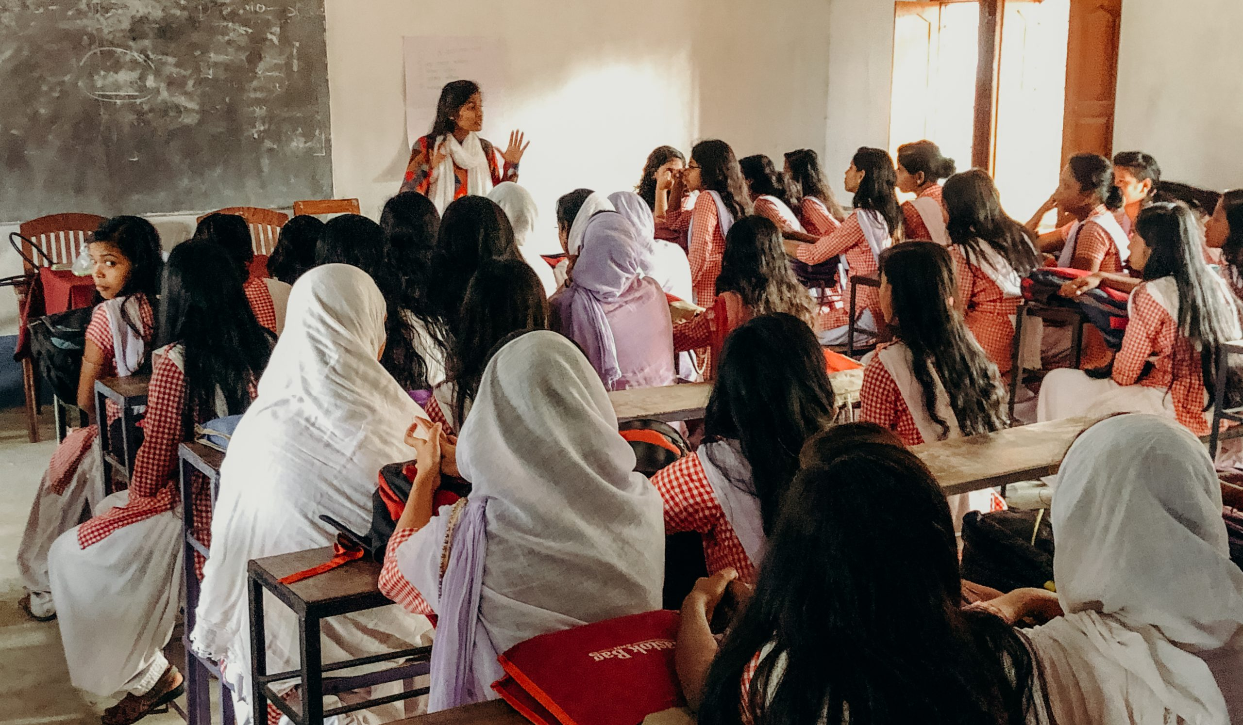 A Shadhika Scholar from the Jabala Action Research Organization hosting a community leadership workshop at a local high school, 2019