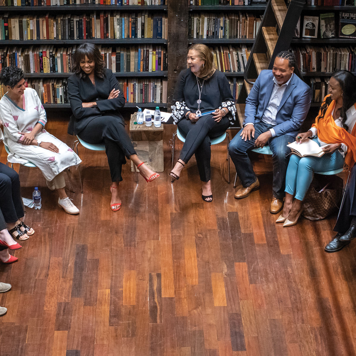 Mrs. Obama speaks with the 2018 Obama Foundation Fellows at their first gathering.