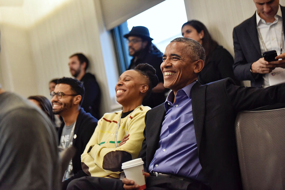 President Obama observes a session at the Obama Foundation Summit.