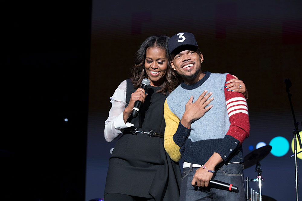 Mrs. Obama and Chance the Rapper speak to the crowd at the Community Event, which concluded the inaugural Obama Foundation Summit.